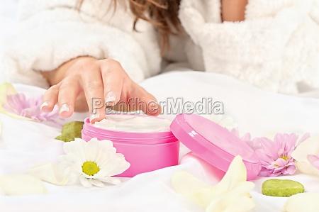 woman taking cream