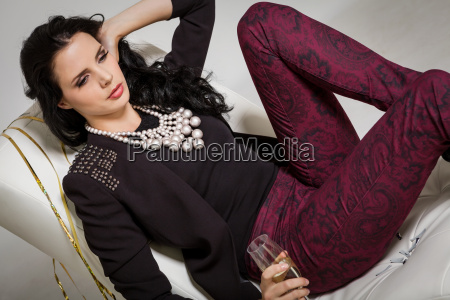 elegant attractive young woman with champagne