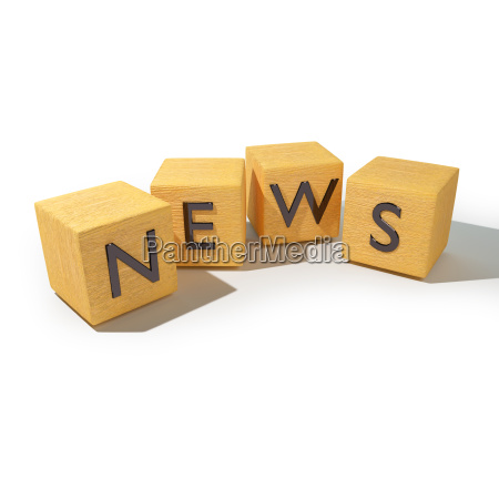 wooden cubes with news