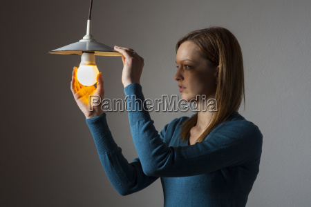 woman with a light bulb
