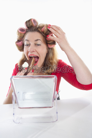 middle aged woman with hair rollers