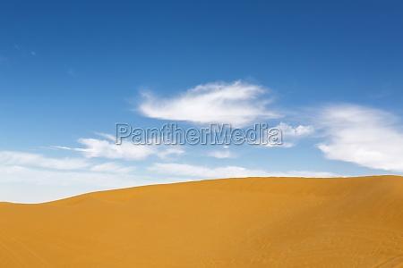 sand dune with blue sky