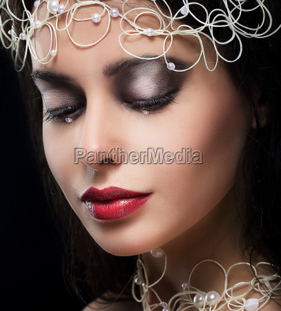 stylish fashionable young woman with pearls