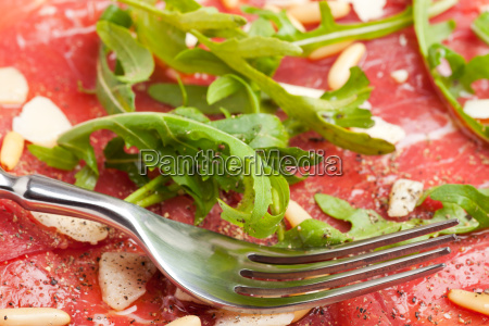 carpaccio on a plate with parmesan