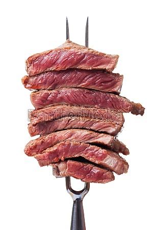 steakscheiben auf einer fleischgabel