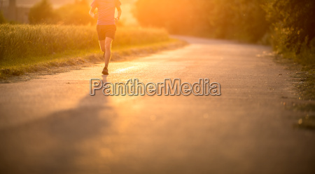 male athleterunner running on road