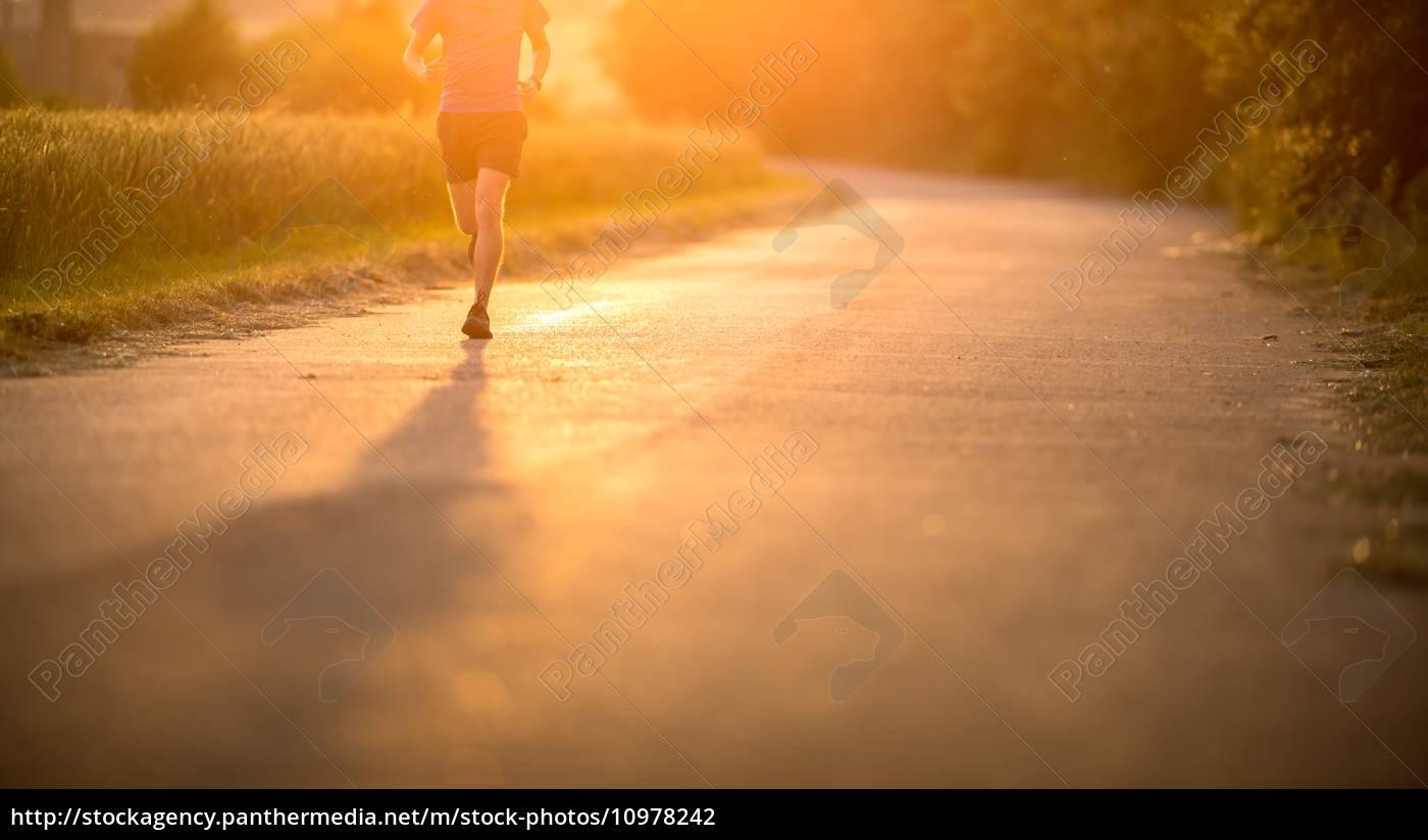 male, athlete/runner, running, on, road, - 10978242