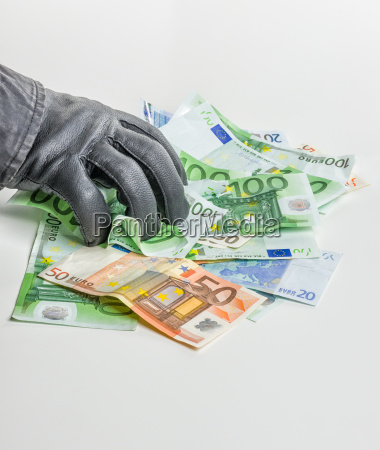 thief with leather glove grabs bills