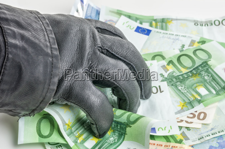 thief with leather glove reaches for