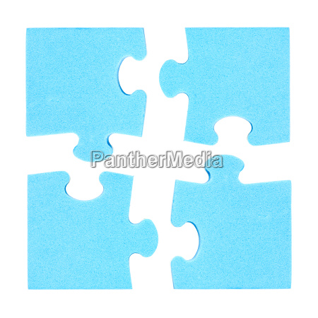 four puzzle pieces combined cooperation