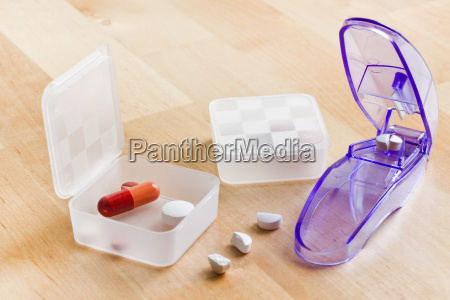 sorting out medication in pillboxes using