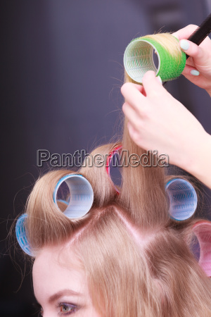 female blond hair curlers head rollers