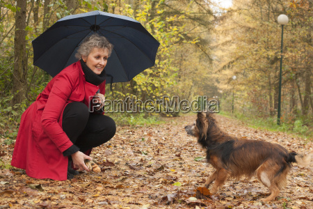 woman playing with her dog and