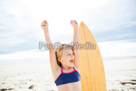 happy young girl with surfboard on