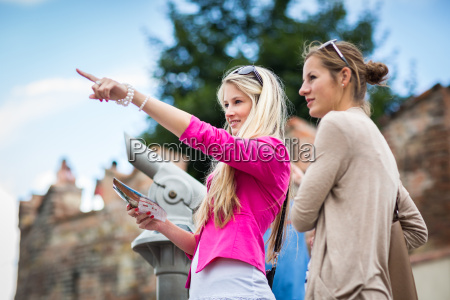two pretty young women sightseeing in