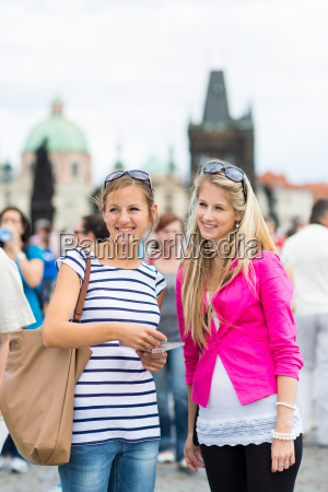 two female tourists walking along the