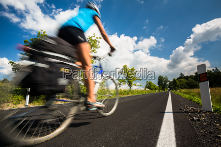 female cyclist biking on a country
