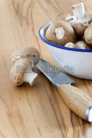 mushrooms and kitchen knife on countertop