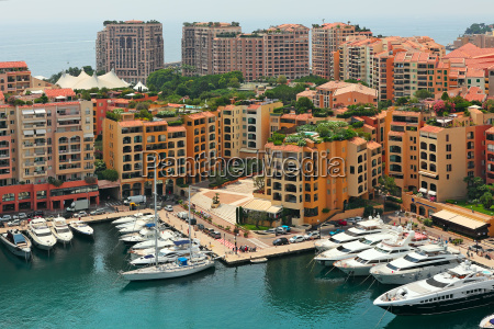 marina with yachts and boats between