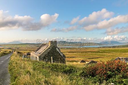 pastureland and ruin in portmagee
