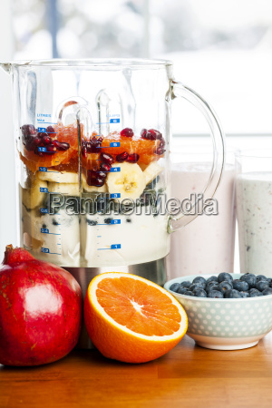making smoothies in blender with fruit