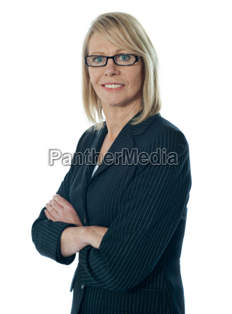 senior female manager posing with arms