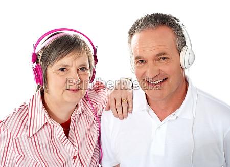 cute senior couple listening to music