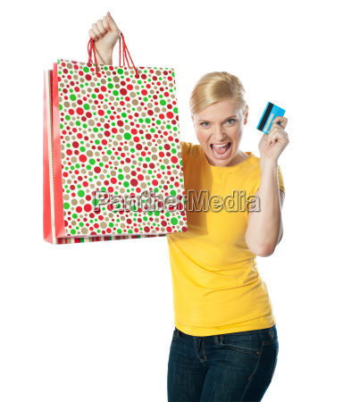shopaholic teenager posing in excitement