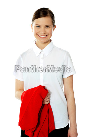 school girl holding her red sweater