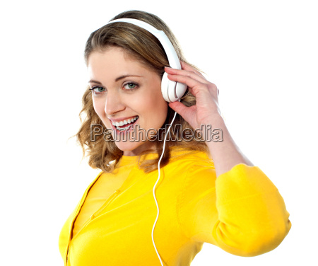 beautiful young woman with headphones listening