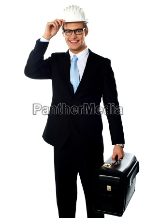 handsome american architect holding a briefcase