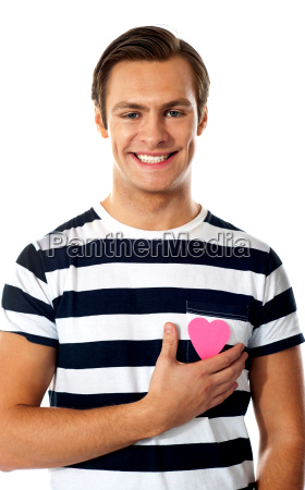 casual man with a paper heart