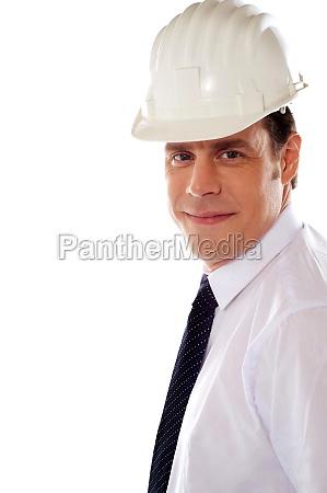 smiling male architect wearing hard hat