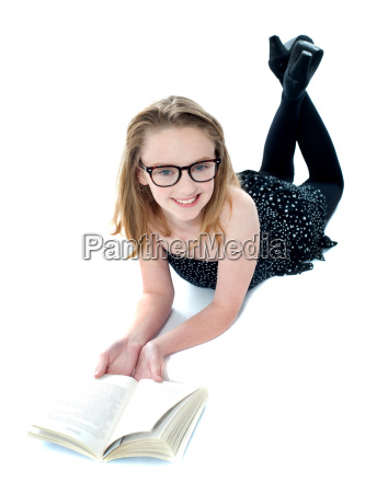 smiling little girl lying with an