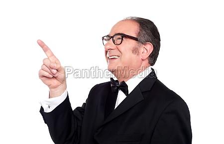 aged man looking and indicating upwards