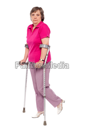 unhappy handicapped woman with crutches