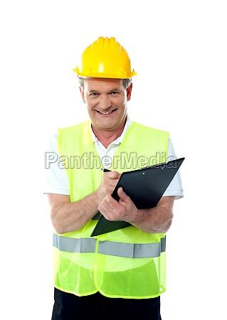 smiling senior construction engineer