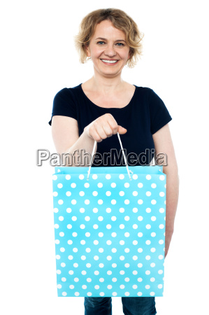 shopaholic female holding shopping bag