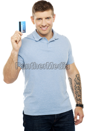 trendy smart male showing credit card