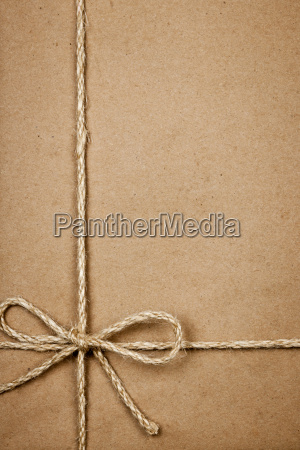 package in brown paper tied with