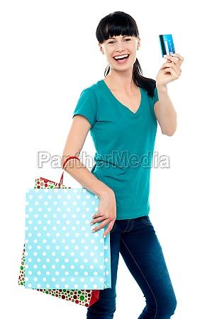 shopaholic woman holding her cash card