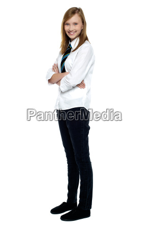 confident high school girl posing with