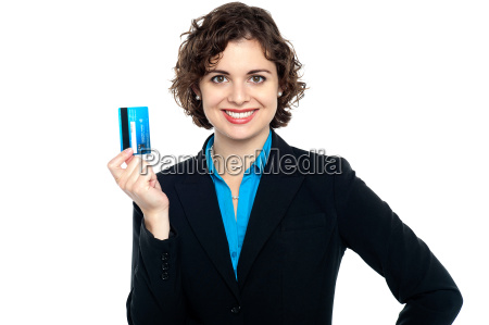 smiling corporate woman holding credit card