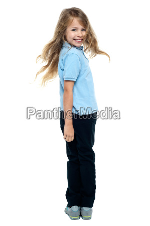 smiling young girl turning towards the