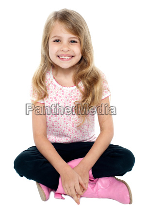 pretty caucasian girl seated on floor