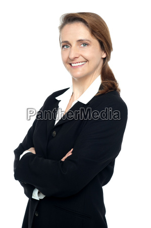 executive in business suit standing arms