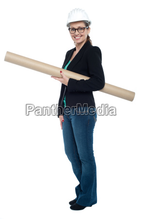 experienced female architect holding site blueprints