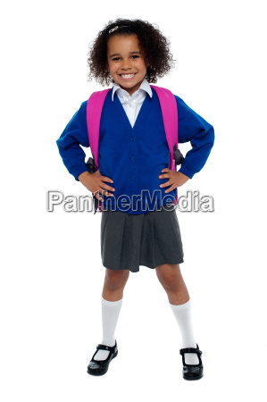 primary school girl posing confidently