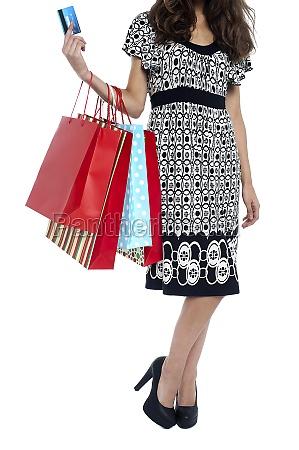 cropped image of a shopaholic woman