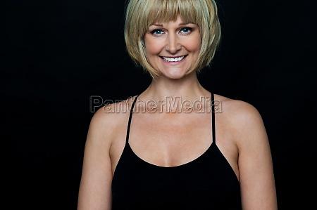 glamorous woman in sleeveless black spaghetti